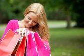 Shopping woman peeking — Stock Photo