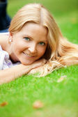 Woman liying on grass — Stock Photo