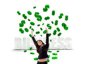 Excited business woman in a dollar's rain — Stock Photo