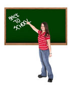 Woman writing 'back to school' in a chalkboard — Stock Photo