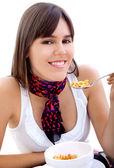 Woman eating breakfast isolated — Stock Photo