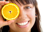 Woman with an orange — Stock Photo