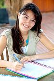 Beautiful woman studying — Stock Photo