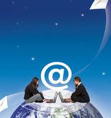 Women sending e-mails — Stock Photo