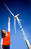 Woman with a windmill — Stock Photo