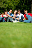 Group of friends at the park — Stock Photo