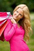 Pensive shopping woman — ストック写真