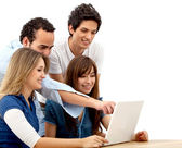 Friends with a laptop — Stock Photo