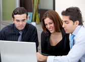 Business group with computer — Stock Photo
