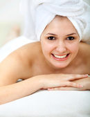 Woman with a towel on her head — Stock Photo