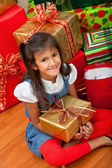 Christmas girl with gifts — Стоковое фото