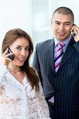 Couple d'affaires sur le téléphone — Photo