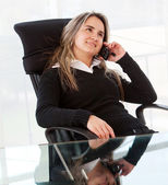 Business woman sitting — Stock Photo
