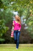 Female walking through campus — Stock Photo