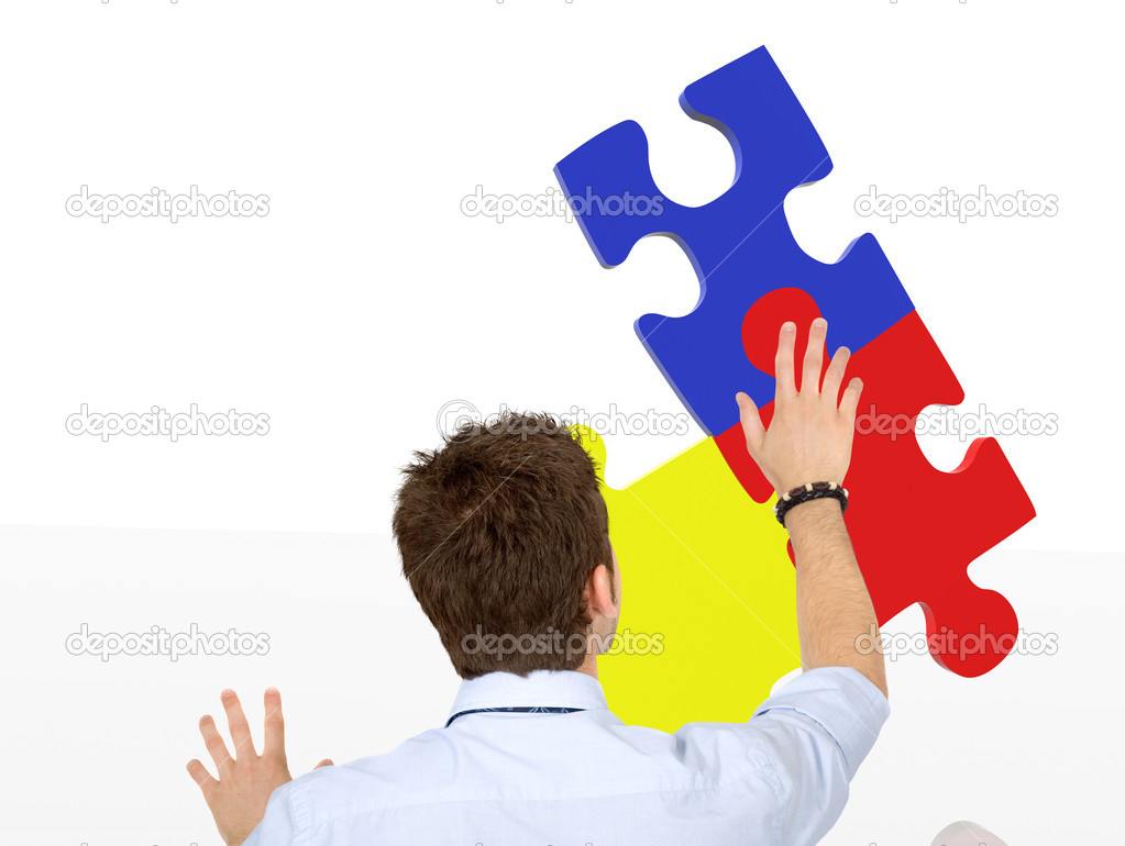 Business man making a jigsaw puzzle isolated — Stock Photo #7731769