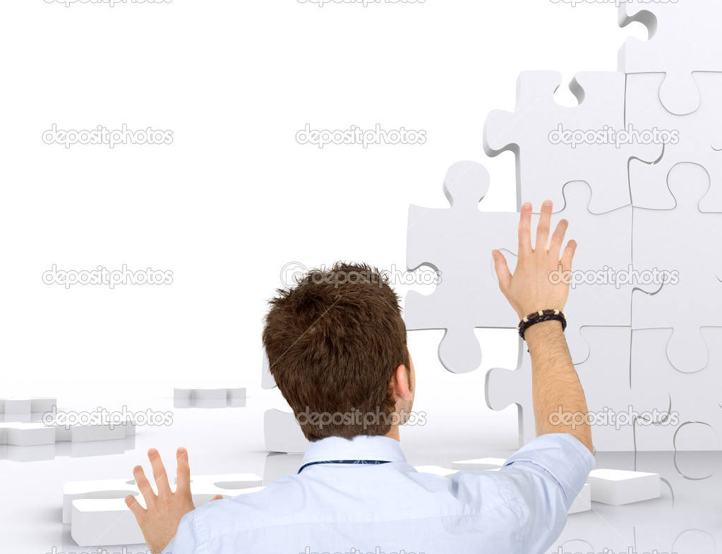 Business man building a puzzle isolated over white  Stock Photo #7731983