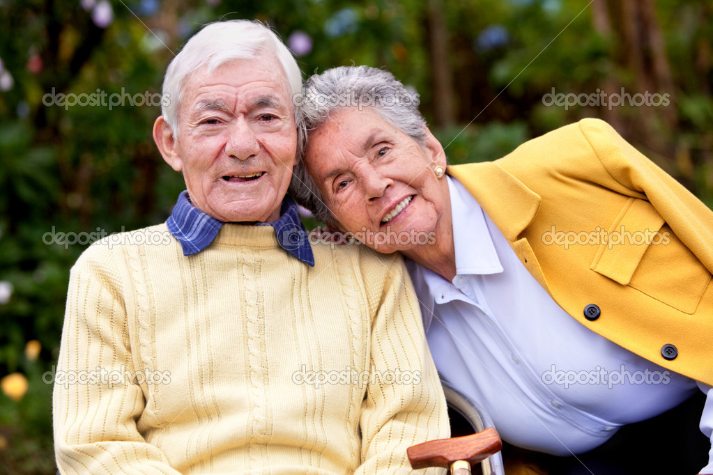 Portrait of a loving elderly couple outdoors  Stock Photo #7732736