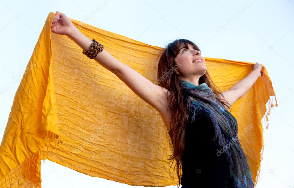 Beautiful woman with an opened pashmina outdoors — Stock Photo #7736447