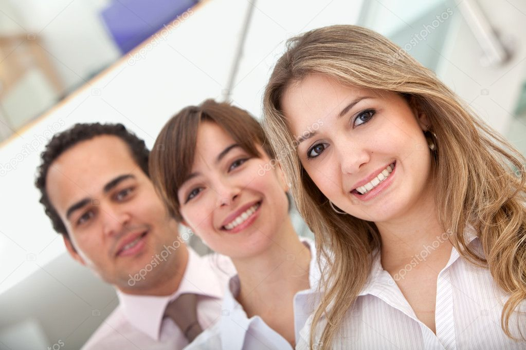 Group of business smiling in an office — Stock Photo #7736562