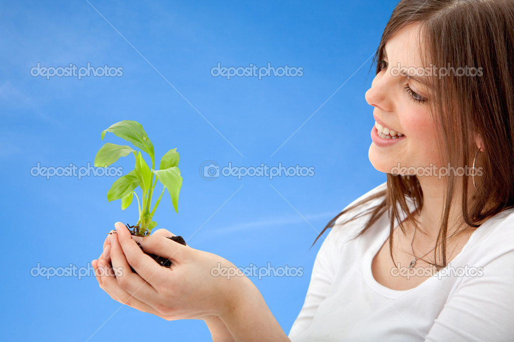 Woman with a plant in her hands outdoors — Stock Photo #7736598