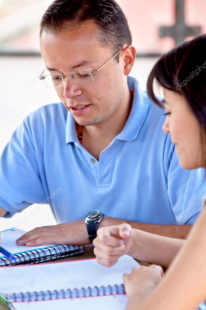 Man and woman portrait studying with notebooks — Stock Photo #7737128