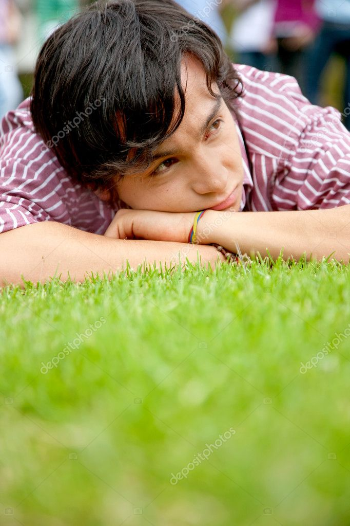 Nostalgic man portrait lying on grass outdoors — Stock Photo #7737201