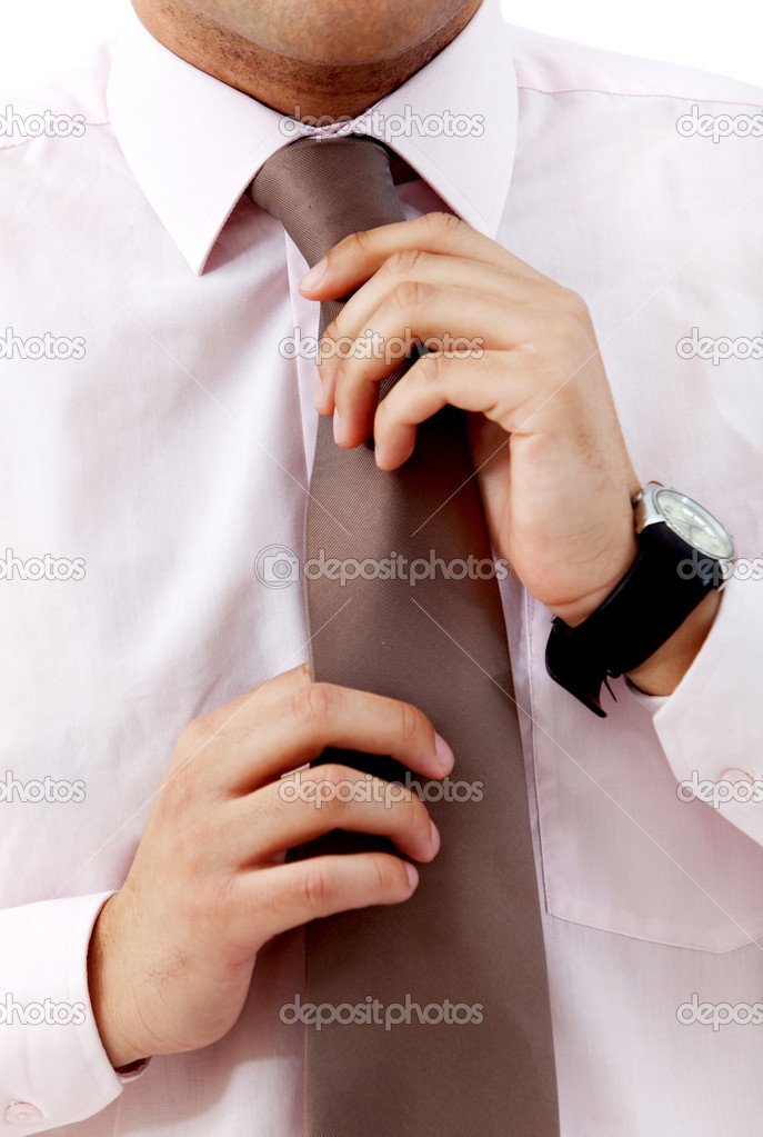 Business man fixing his tie isolated on white — Stock Photo #7737402