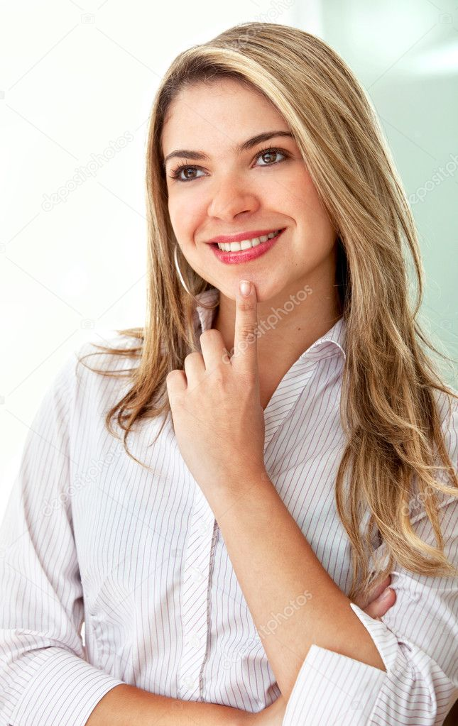 Pensive business woman at the office smiling — Stock Photo #7739805