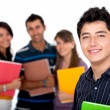 Stock Photo: Male student with a group