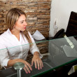 Stock Photo: Female receptionist