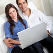 Couple with a laptop - Stock Photo