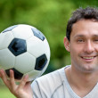 Stock Photo: Man with a soccer ball