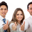 Stock Photo: Thumbs up business team