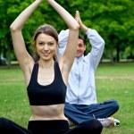 Couple doing yoga — Stock Photo