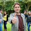 Man with thumbs up outdoors — Stock Photo #7740536