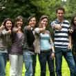 Stock Photo: Large group of friends with thumbs up