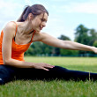 Girl stretching - Stock Photo