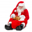 Santa with a gift — Stock Photo #7741003