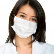 Female doctor with facemask — Stock Photo #7741018