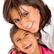 Mother and daughter smiling — Stock Photo