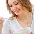 图库照片: Woman eating cereals
