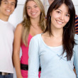Beautiful girl with a group — Stock Photo #7741149