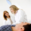 Royalty-Free Stock Photo: Doctors examining a patient