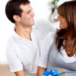 Woman getting a gift — Stock Photo #7741213