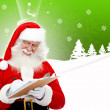 Santa writing a list — Stock Photo #7741271