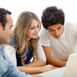 Group of with a laptop — Stock Photo #7741318