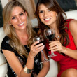 Women with wineglasses - Stockfoto