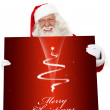 Santa with a Christmas poster — Stock Photo