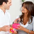 Woman giving a gift to a man — Stock Photo