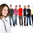 Stock Photo: Female doctor with a group of